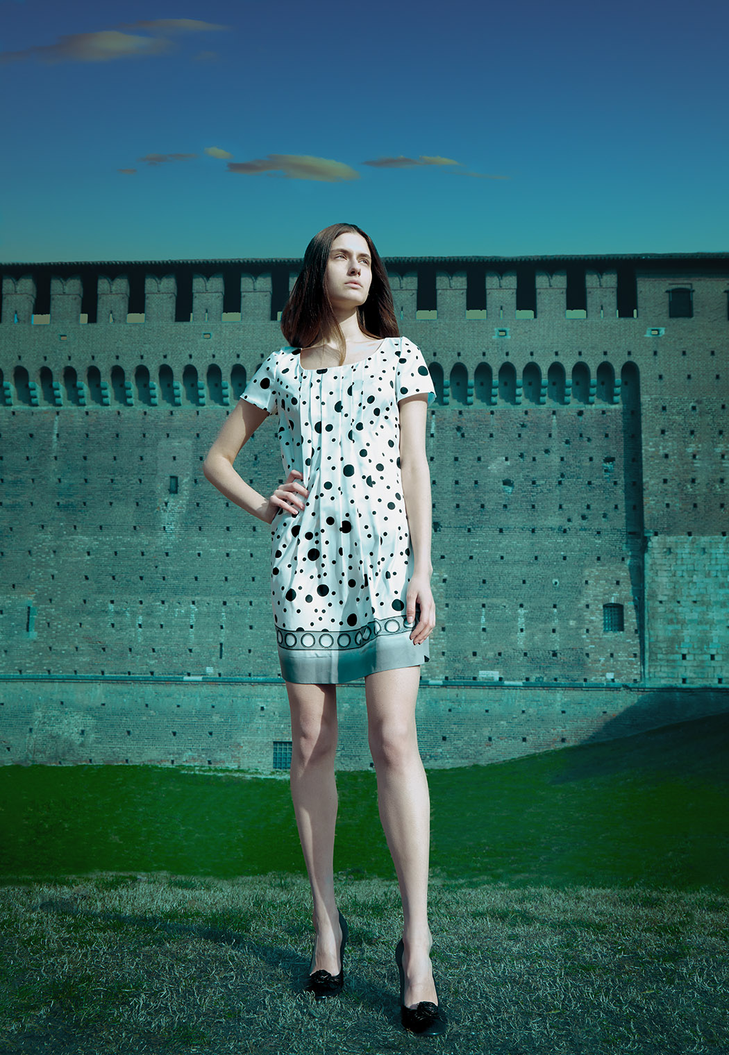 girl in dotted dress at a castle in Milan, Italy