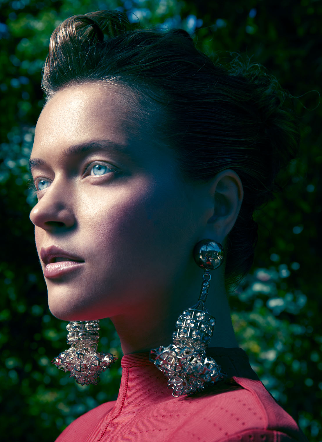 fashion portrait of beautiful woman with robot and cyborg looks in high end lighting style