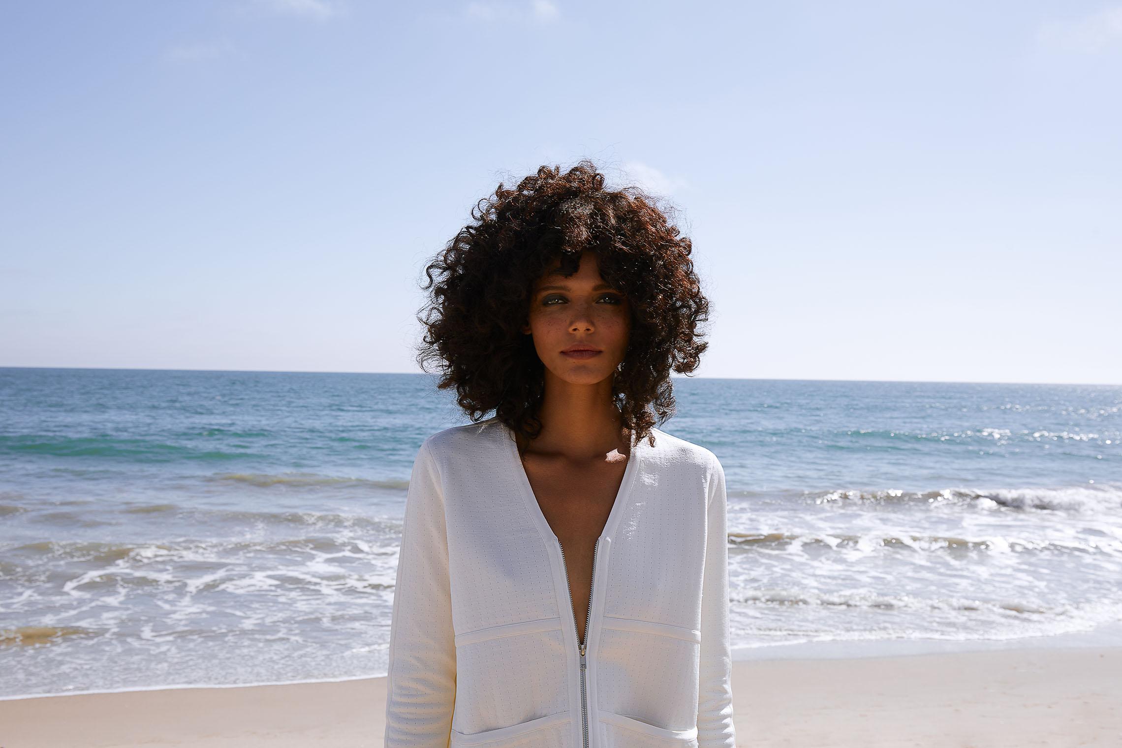 LA fashion photographer shoots fashion model at Pacific Ocean Coast-in-Malibu