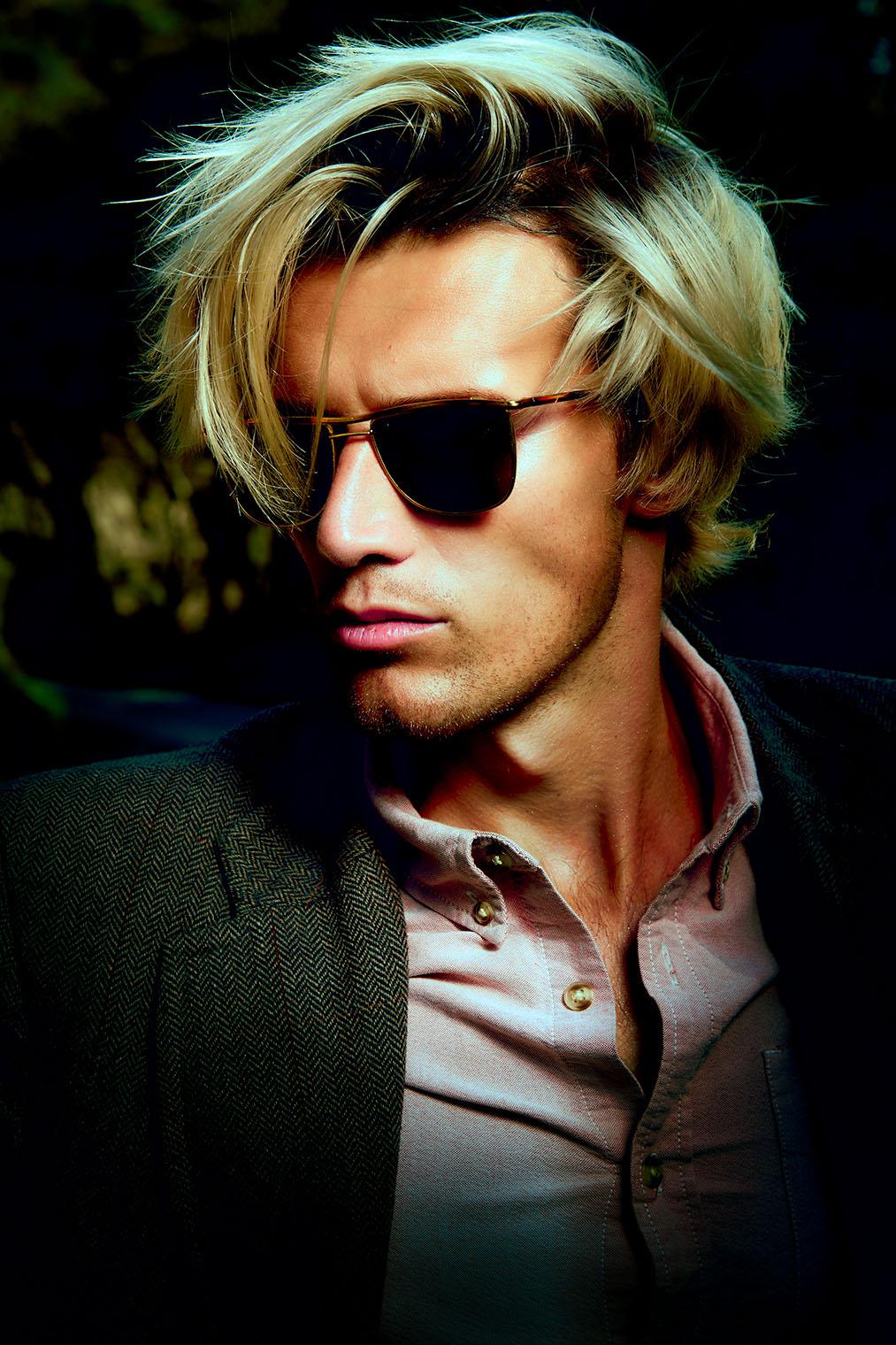fashion portrait of man wearing sunglasses highly stylized portrait photograph