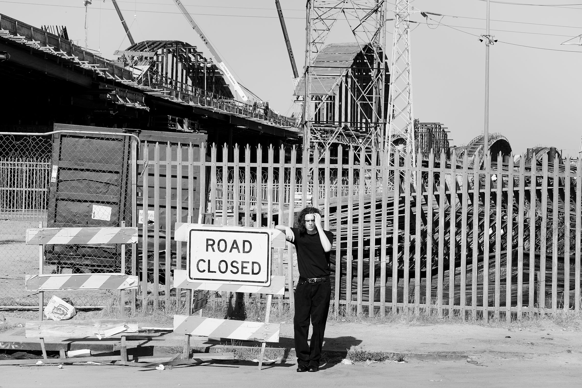 male fashion shoot - mensstyle- at construction site of bridge in Los Angeles, California by best male fashion photographer