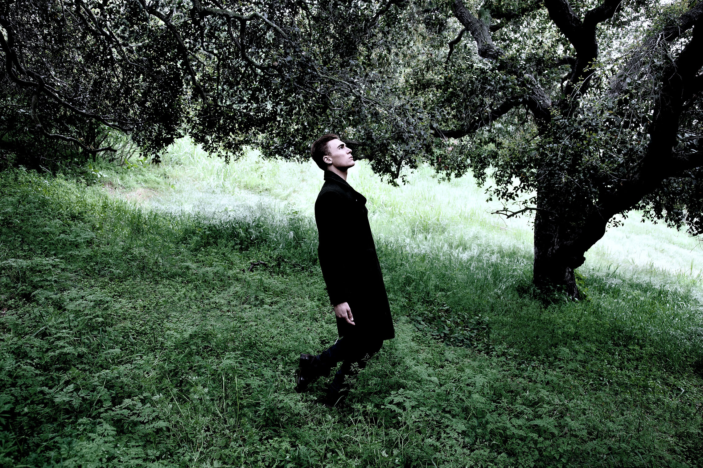 philosopher walking under tree thinking in mens male fashion and accessories editorial in Los Angeles