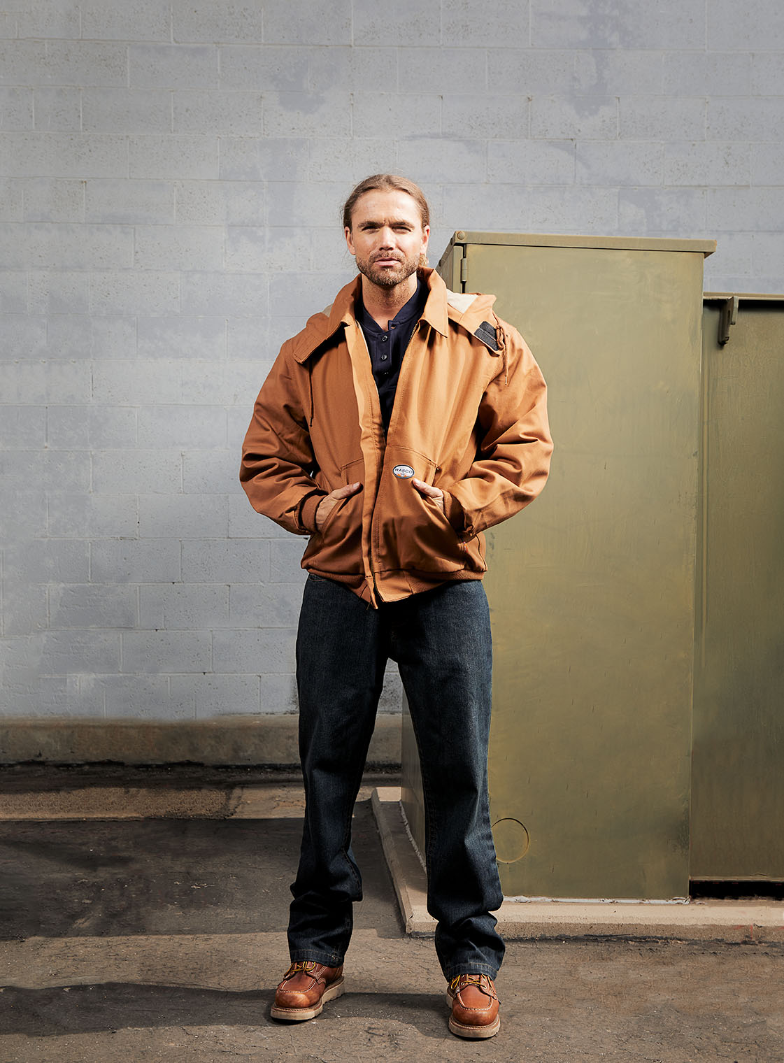 man in tough work vest in workwear ad campaign