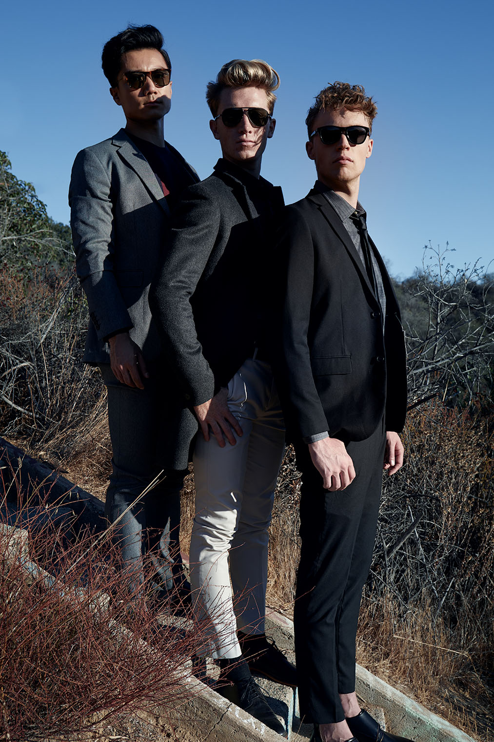 Three good friends, well dressed and fashionable men at mensstyle fashion shoot in LA