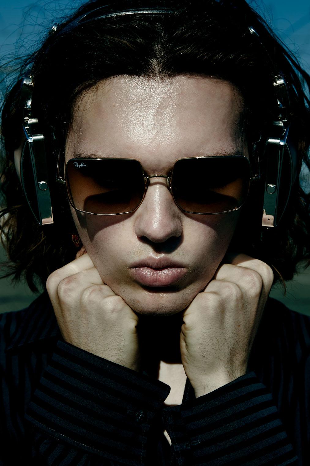 man with headphones - stylish fashion portrait closeup
