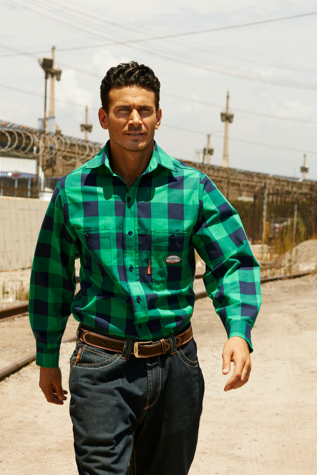 worker in plaid work shirt in workwear catalog advertising photography