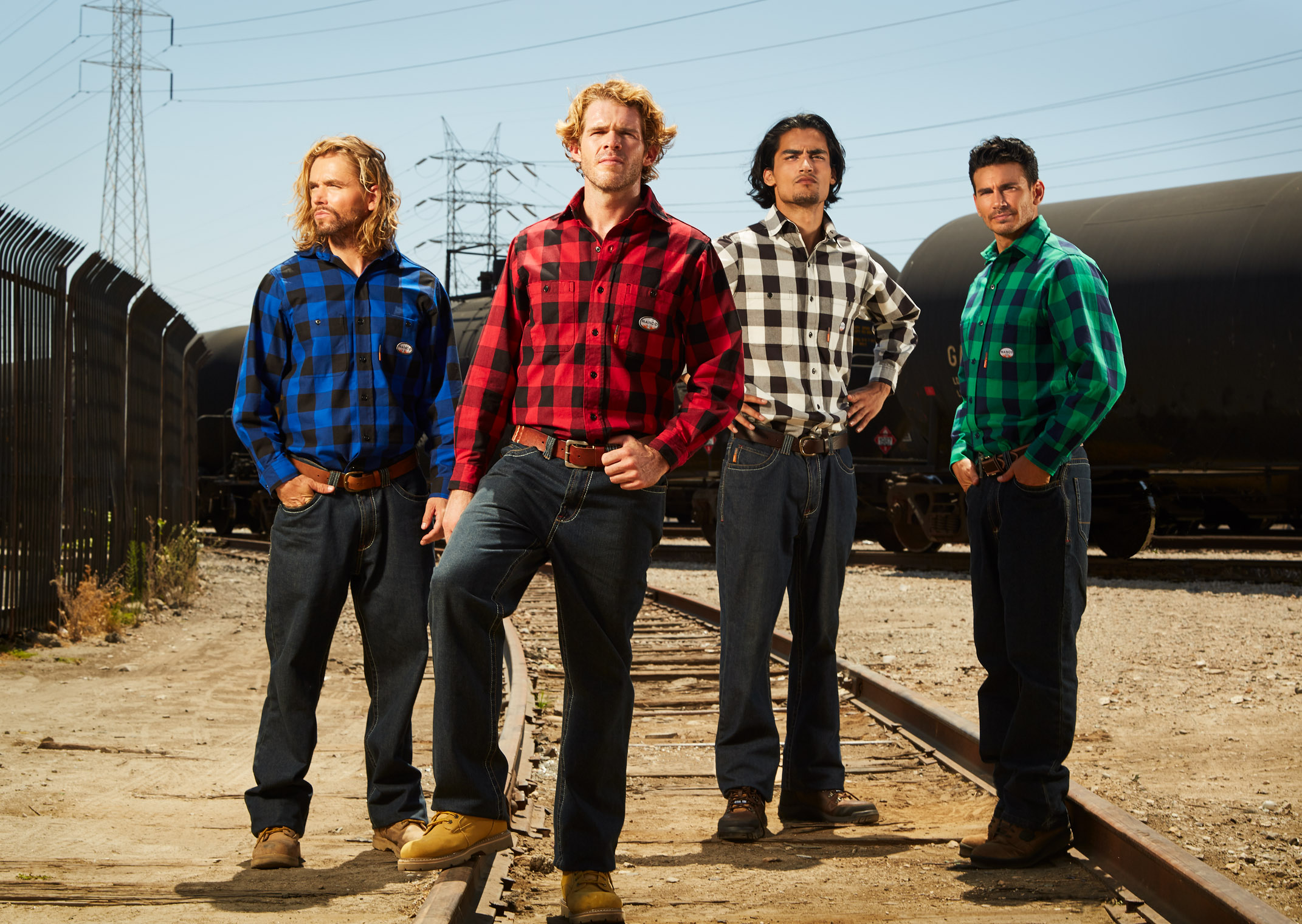 four workers in plaid shirts ready to take on work - tough guys workwear photoshoot LA New York