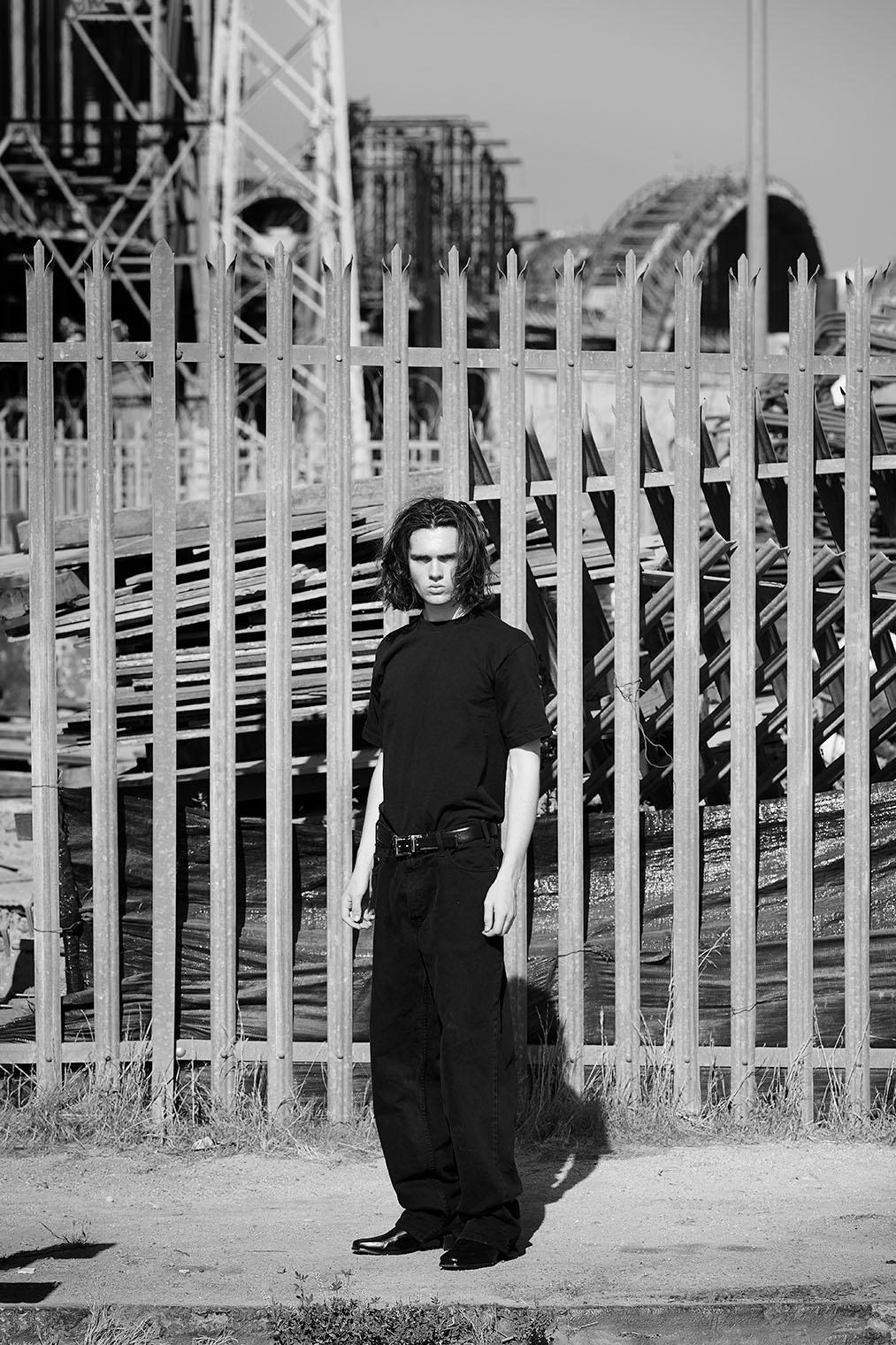 mensstyle photo shoot at bridge in LA - male model in black denim