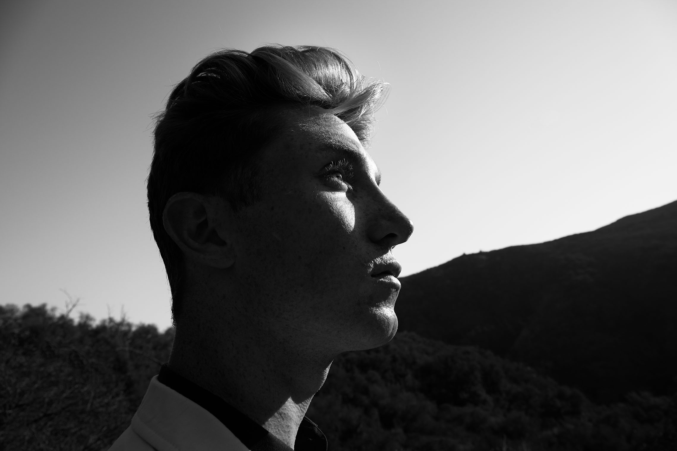 profile portrait with distorted head in nature black and white high contrast