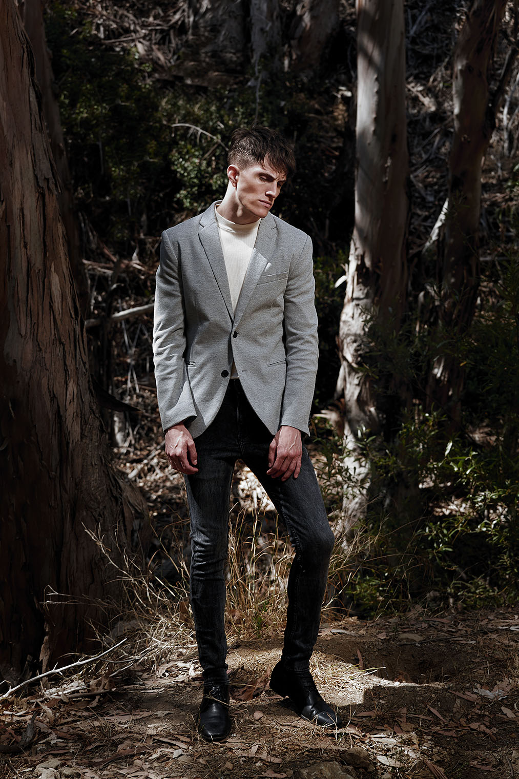 man wearing dinner jacket in forest in mensstyle fashion shoot in California