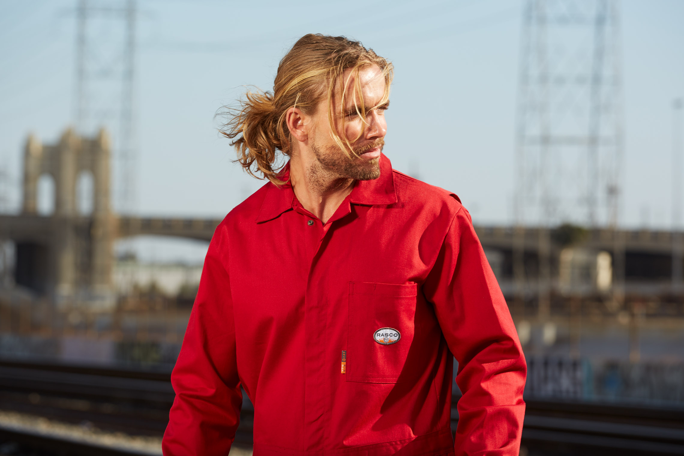 tough worker in red jumpsuit in workwear advertising campaign photographed by Robert Wilde in Los Angeles