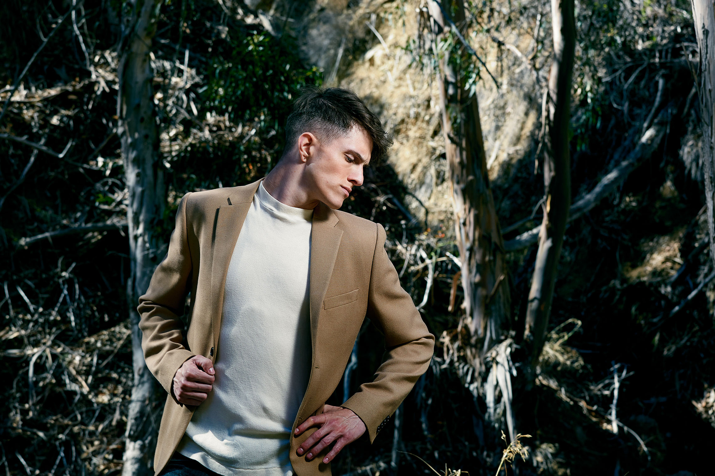 man in stylish jacket in the woods near LA, looking pensively, fashion and accessories shoot by Robert Wilde, LA and New York