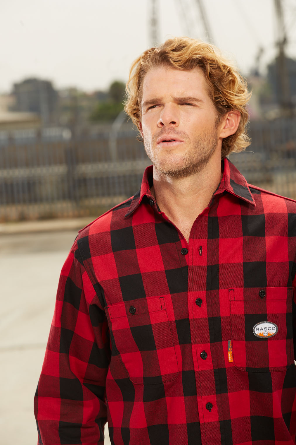 worker in red plaid shirt on construction site in Los Angeles