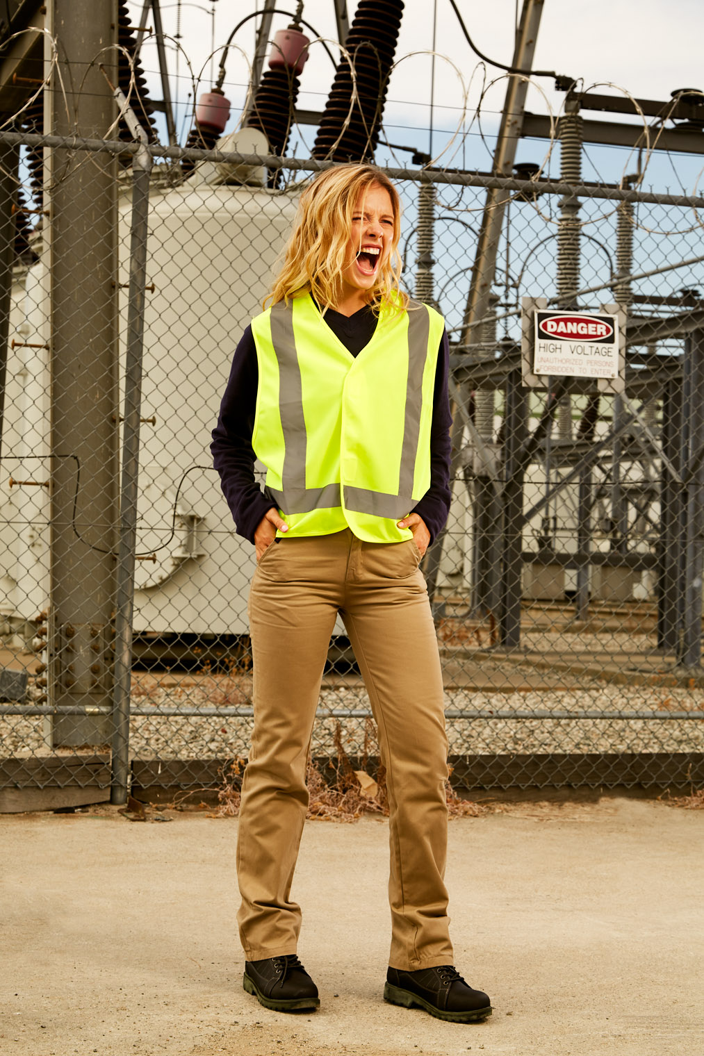 woman in flame retardant reflective vest on worksite - workwear photoshoot Los Angeles