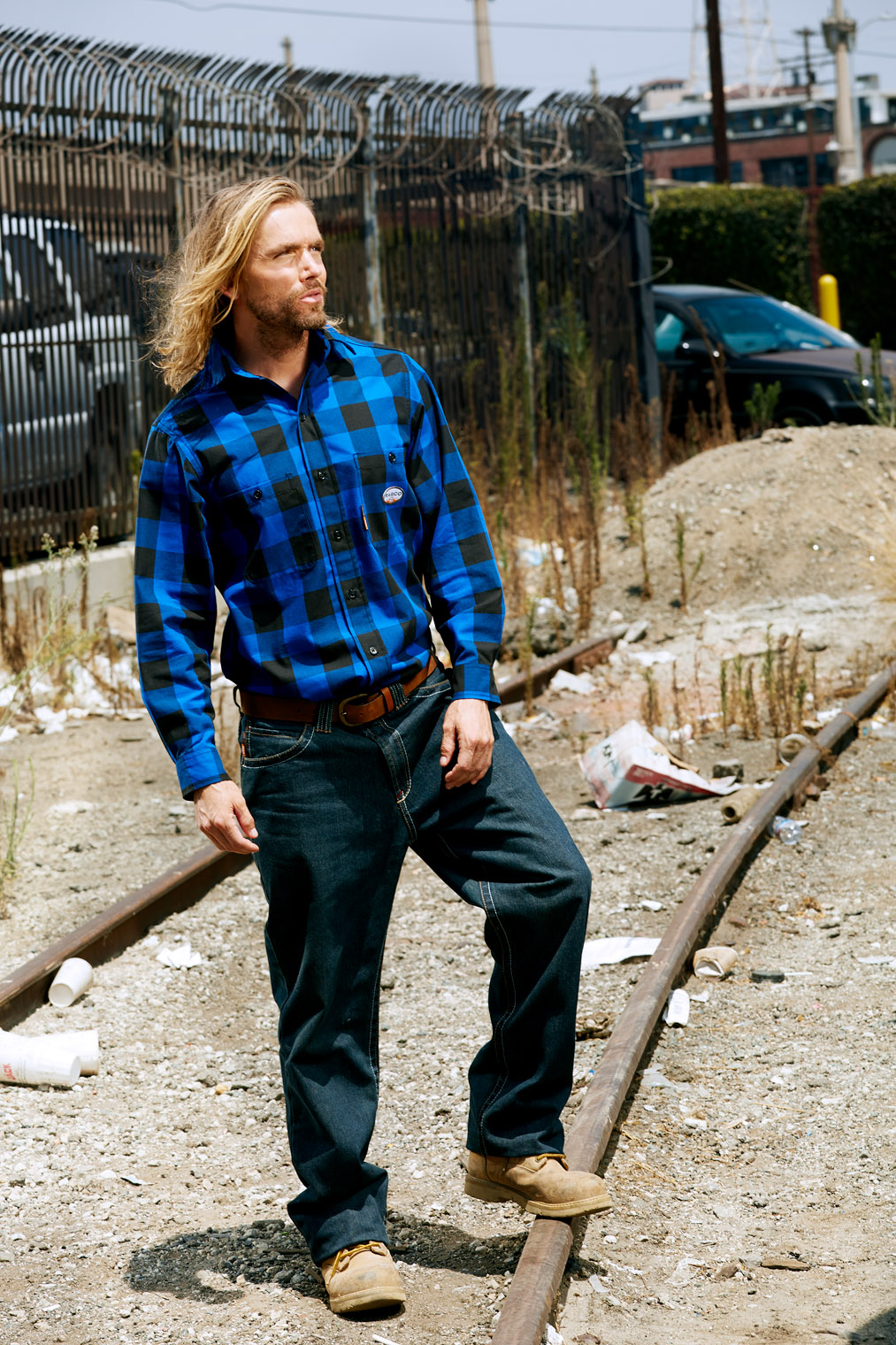 tough hard worker in blue plaid shirt ready to do hard work story