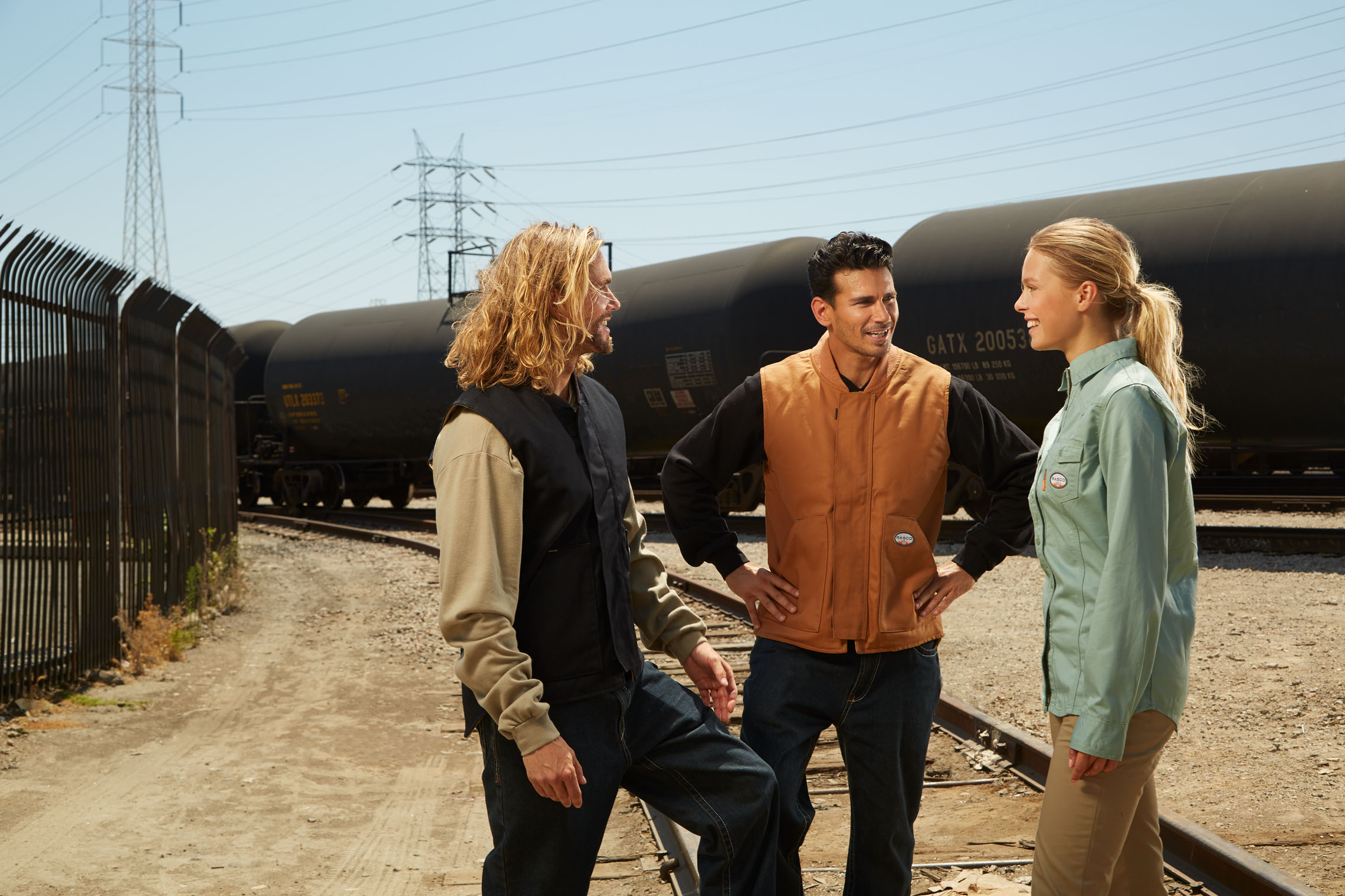 crew of four workmen discussing work with pleasure on workwear photography set in Los Angeles, California