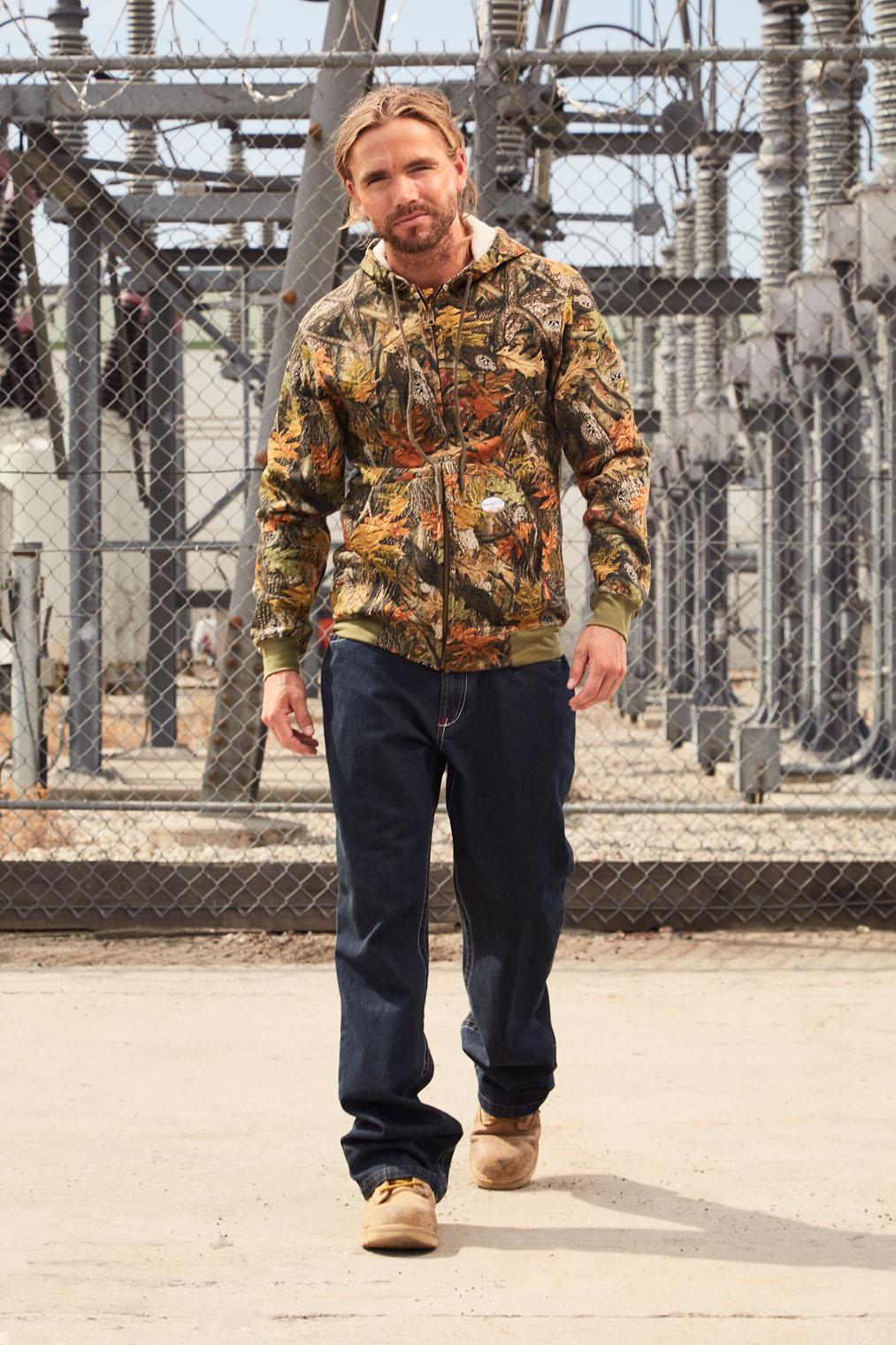 man in work uniform walking to work fashion shoot