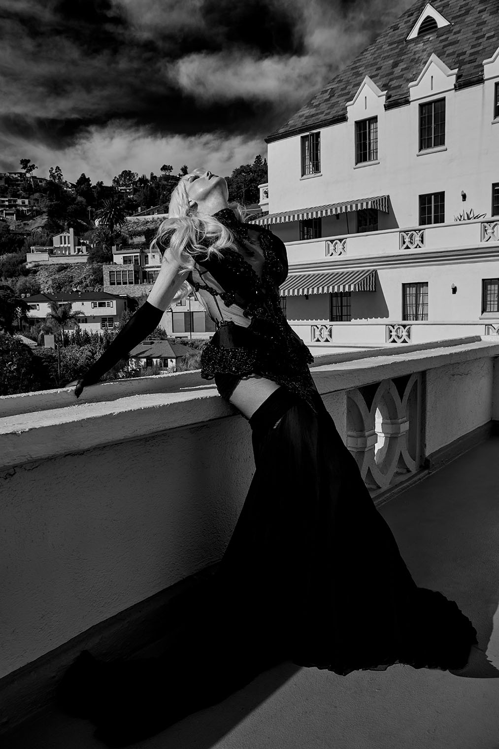 High fashion gown in black worn by actress at Hollywood Chateau Marmont fashion editorial photography shoot