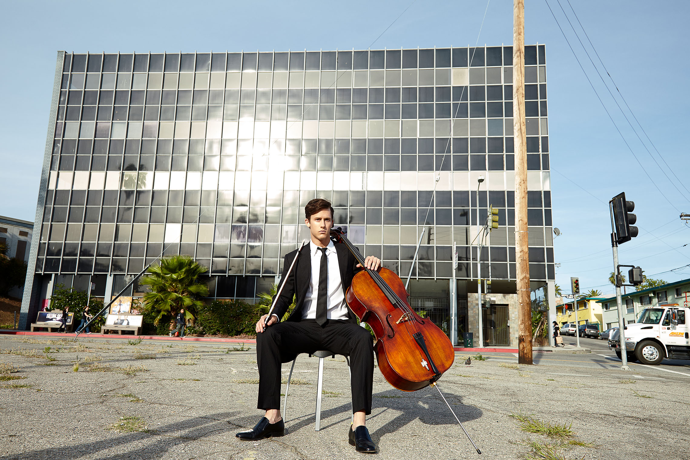 man with violoncello playing on Hollywood square in portrait photograph