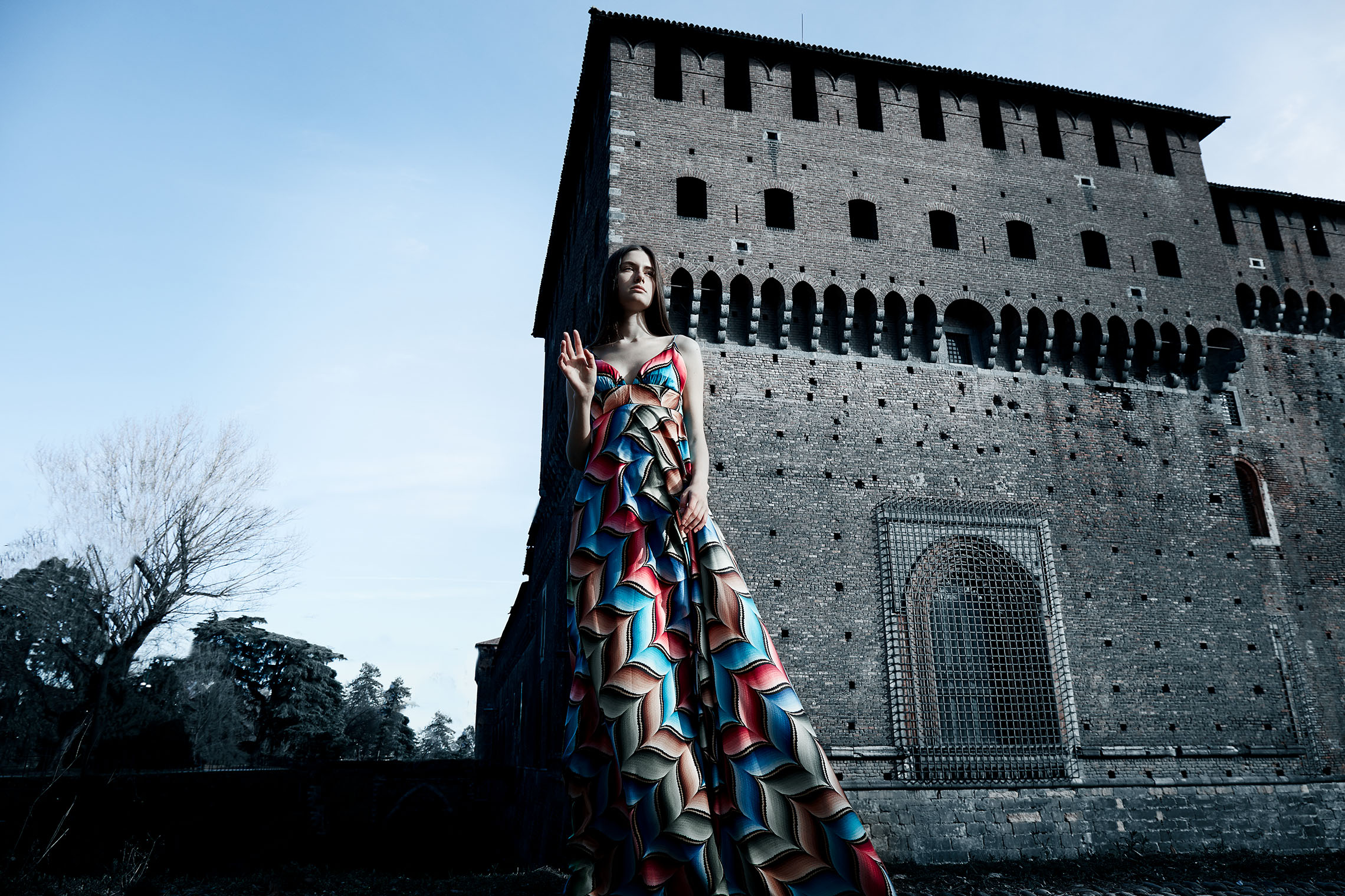 elegant woman and castle - dramatic fashion story - fashion advertising campaign photographed in Milan, Italy