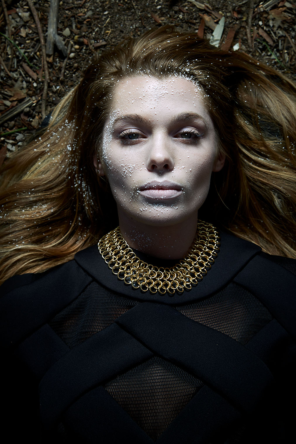 Asleep or dead? Beauty with pale skin and calm expression in dark portrait photograph