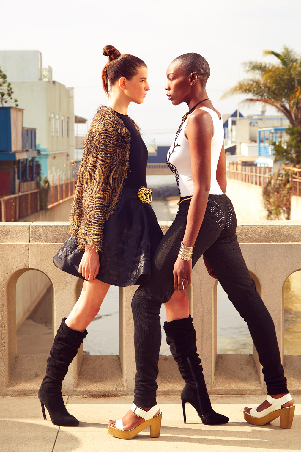 Best Frenemies fashion editorial two women facing off each other intense colors
