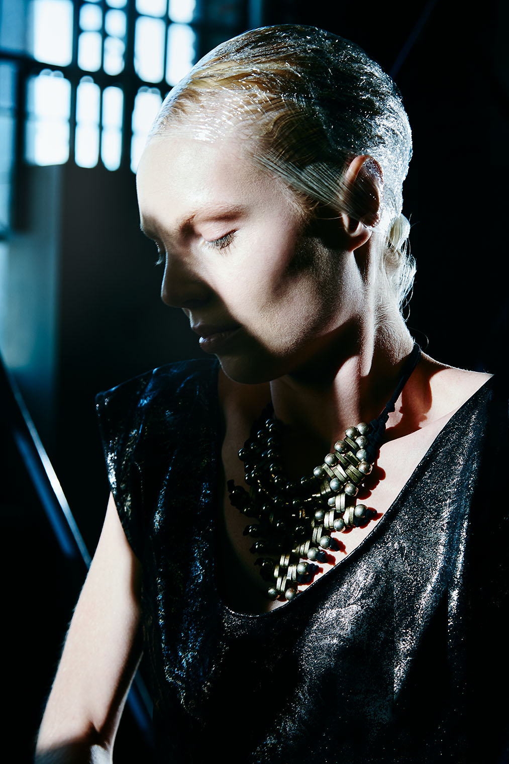 fashion woman in direct light great cheekbones