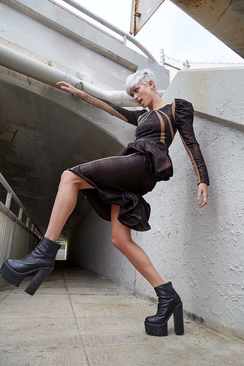 woman in black outfit strong movement in fashion photograph