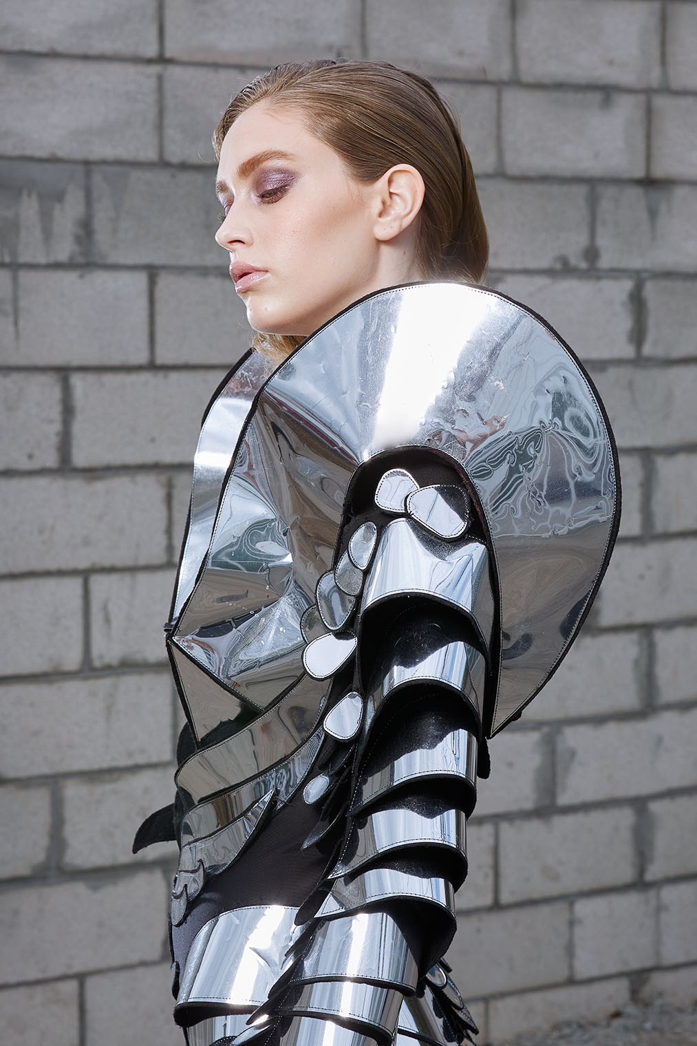 woman in silver clothing - best fashion photographers los angeles