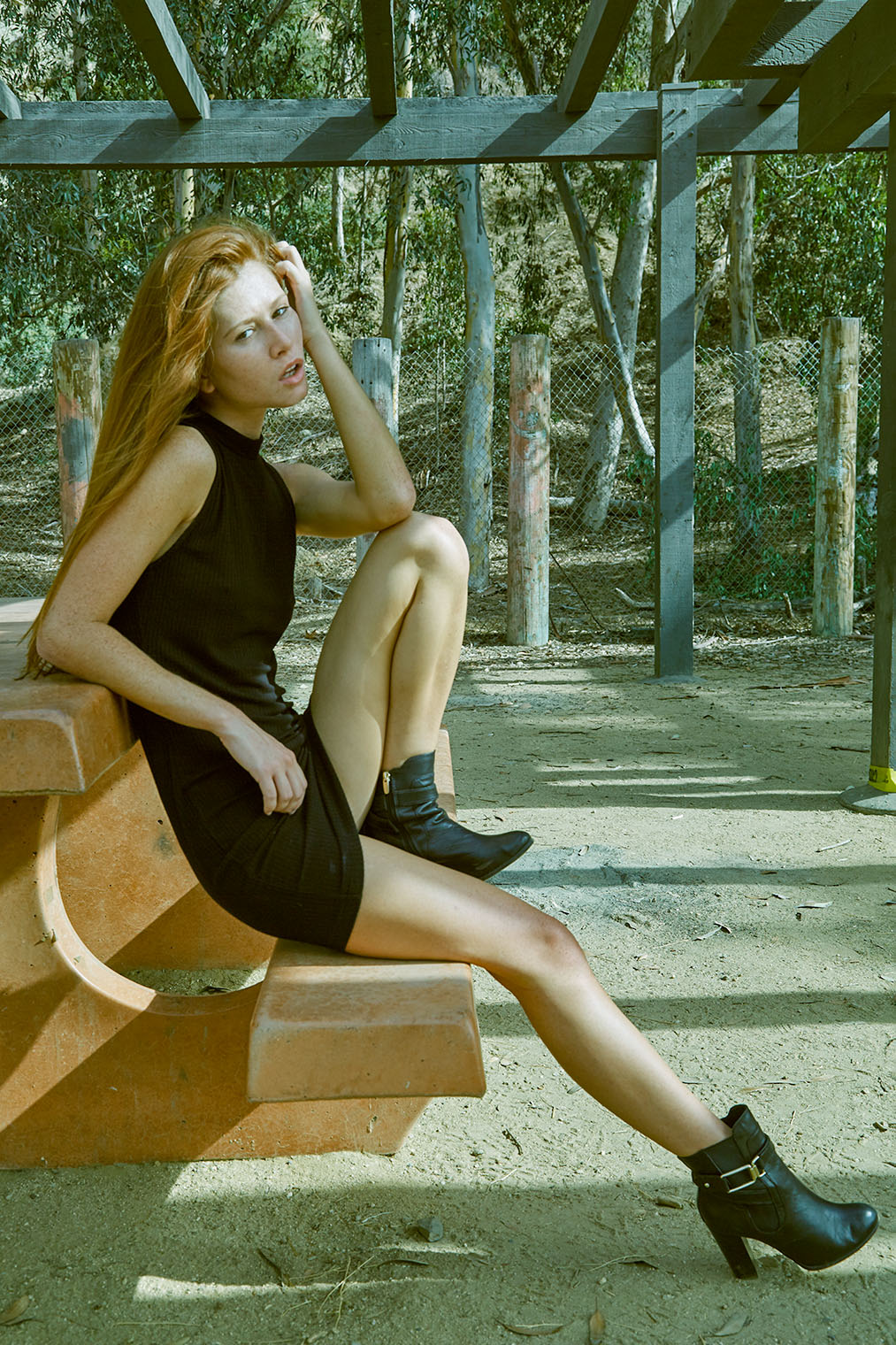 girl experiencing strong emotion sitting on bench in park
