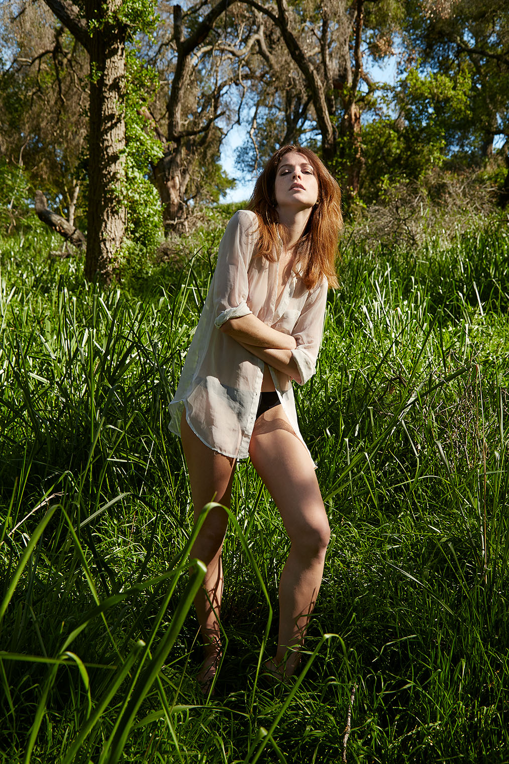 seductive wild girl in the woods luring in her lover - fashion editorial