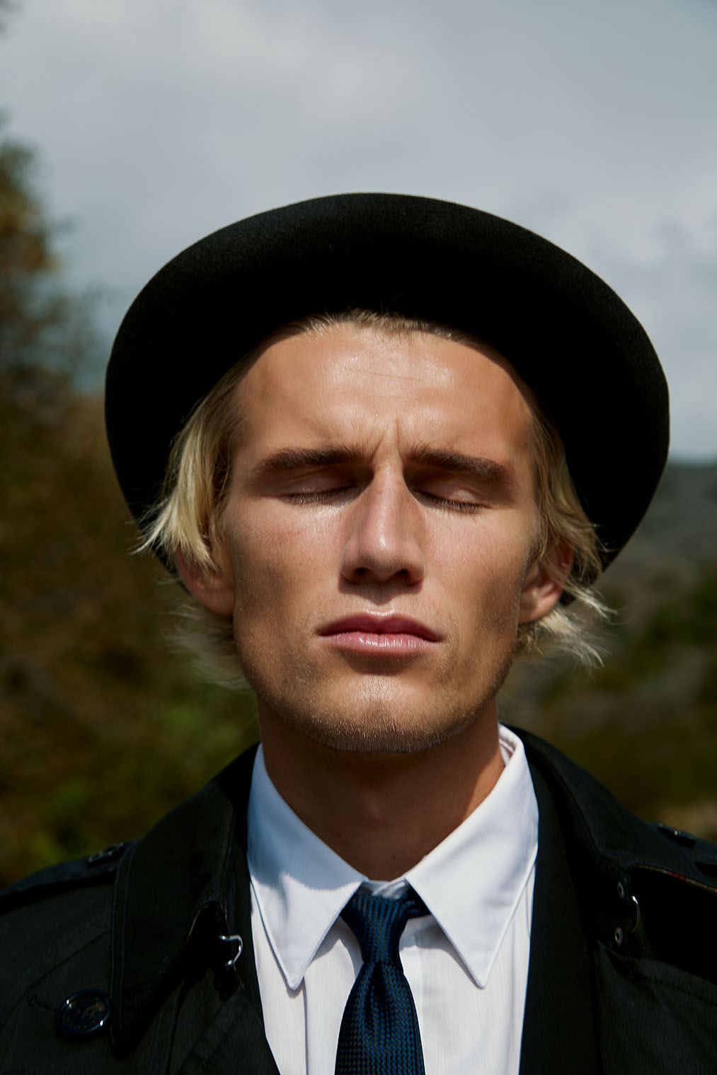 The deep emotion makes his face look ethereal - fashion portrait photographed in Malibu, California