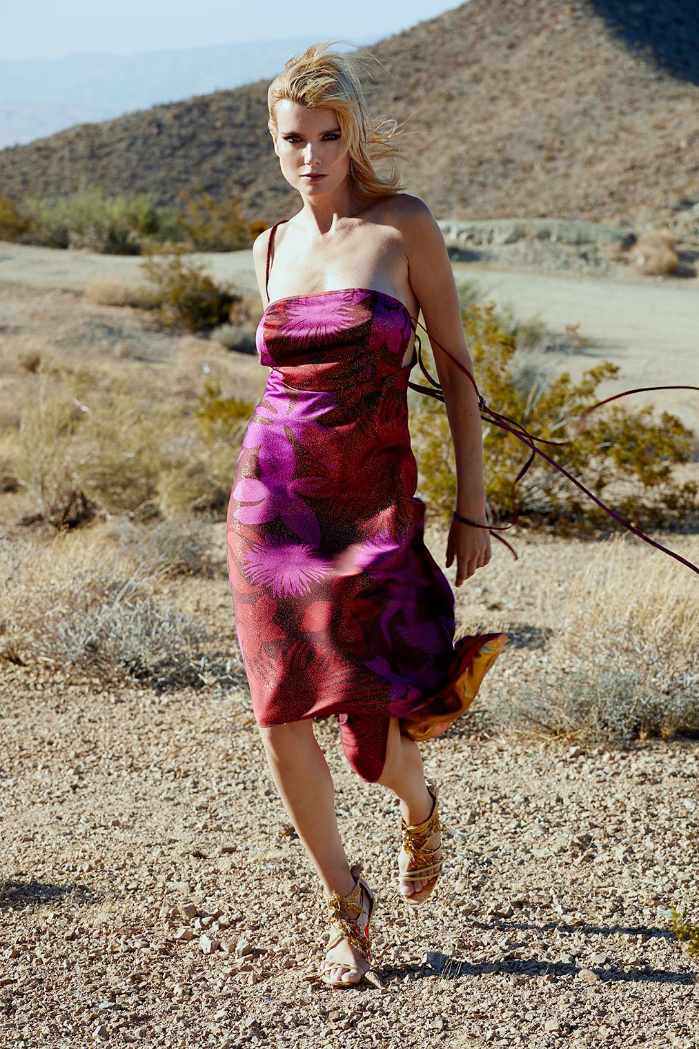 woman in silk dress walking the desert in purple silk dress in fashion advertising campaign, Palm Springs California