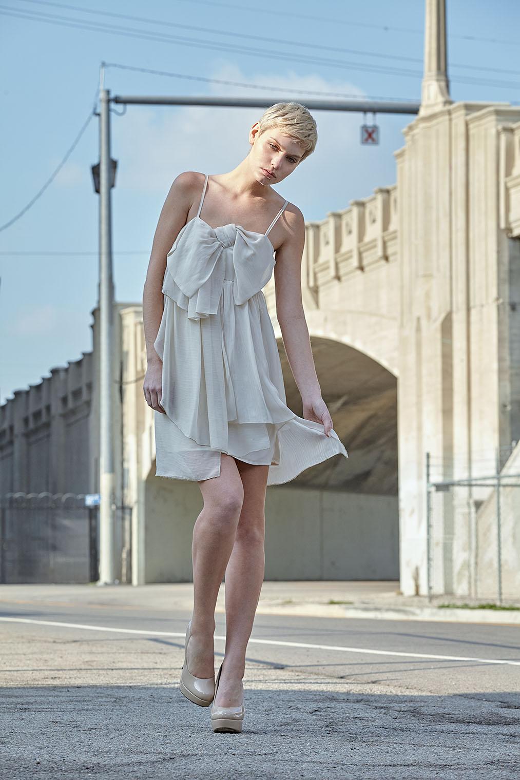 woman in emotion in a white dress in downtown LA