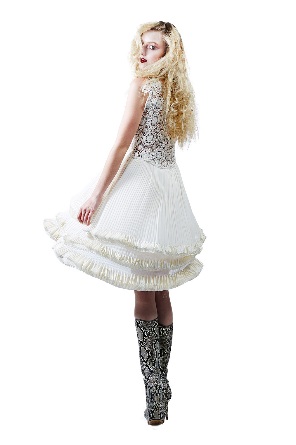 girl in dress with ruche frills turning around with mystery eyes