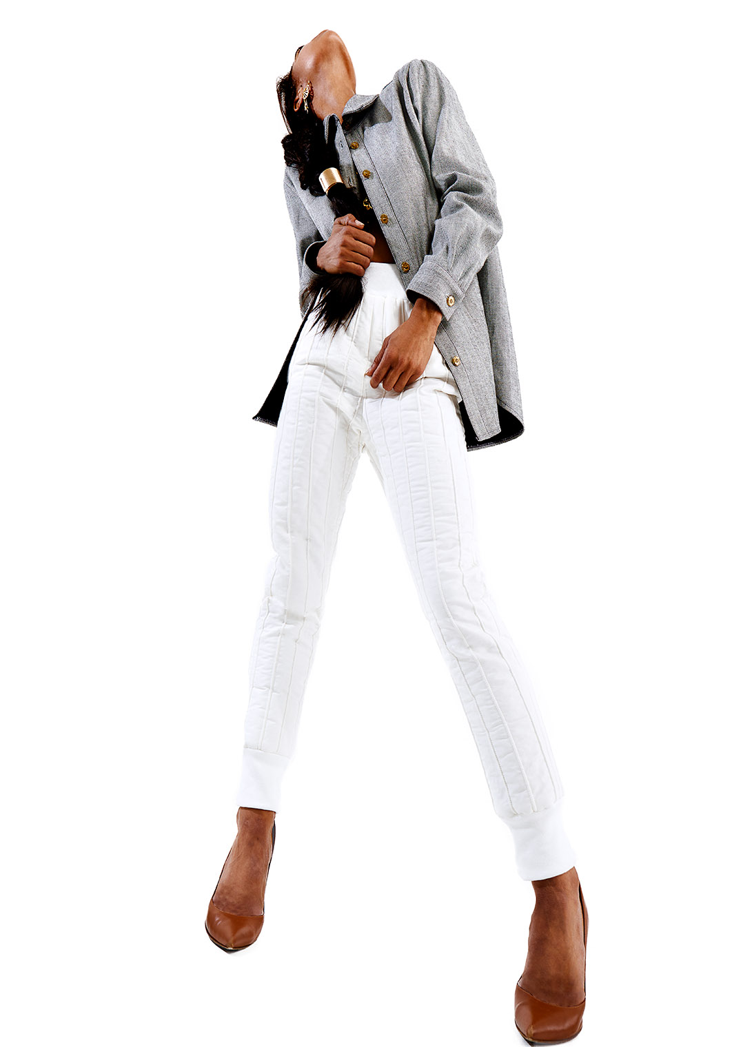 fashion model in white pants and gray jacket in dancing expressive pose at fashion photograph studio in Los Angeles